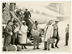 [Musicians and others exiting Sabena airplane. Left to right: Stewardess, Roy Eldridge, Ella Fitzgerald, Dizzy Gillespie, Lou Levy, and Paul Smith, ca. 1956.] [Black-and-white photoprint.]