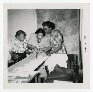 Women Cutting Fabric