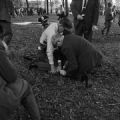 Police officers and two other men restraining a civil rights demonstrator on the ground during a protest at Kelly Ingram Park in Birmingham, Alabama.