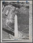 This aerial view shows demonstrators gathered near the Washington Monument (foreground) for the start of March on Washington ceremonies here 8/28. Entertainers are performing on the stage at upper right. The tent at upper left is March headquarters