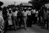"""Juanita Abernathy, Ralph Abernathy, Coretta Scott King, Martin Luther King, Jr., James Meredith, Stokely Carmichael, Floyd McKissick, and others, participating in the """"March Against Fear"""" through Mississippi."""