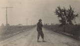 African American man standing in the middle of a dirt road in rural Jefferson County, Alabama.