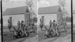 Darkie children standing on their heads. N. Carolina