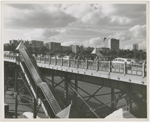 View of pedestrian and traffic overpass connecting West 155th Street to the Macombs Dam Bridge, in Harlem, New York, with the apartment buildings along Edgecombe Avenue visible in the background, ca. late 1940s