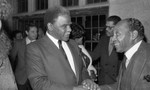 Mayor Harold Washington talking with an unidentified man at an event, Los Angeles, 1983