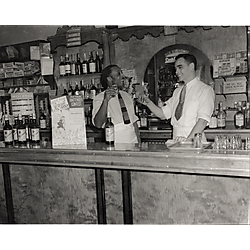 The manager toasting the bartender at Rosens Music Bar on Liberty Avenue