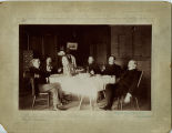 Five men at table