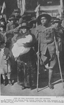 One of the wounded [a member of the famous 369th Colored Infantry] and his mother