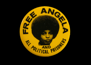 Pinback button with [FREE ANGELA AND ALL POLITICAL PRISONERS]