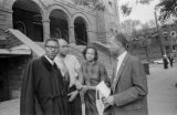 M. W. Pippen and his daughter, Juanita Jones, with two men in front of 16th Street Baptist Church in Birmingham, Alabama, after the building was bombed.