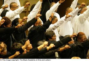 Choir members raising a fist
