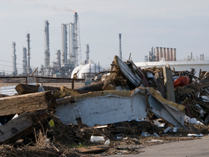[Severe Storms and Inland and Coastal Flooding] Port Arthur,TX, September 17,2008 -- Debris lines the side of a road near an oil refinery in Port Arthur,TX left in the wake of Hurricane IKE. Photo by Patsy Lynch/FEMA