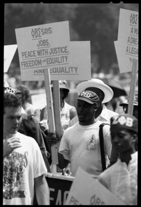 Black fraternity members (Phi Beta Sigma) carry signs for 'Jobs, Peace with Justice, Freedom and Equality,' 25th Anniversary of the March on Washington