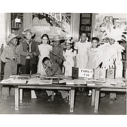 Children in costumes with a book display at McKelvy School on Bedford Avenue, Hill District