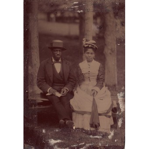 African-American couple outside with an umbrella