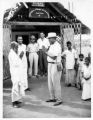 Here I [Leo B. Marsh] am greeting the president of what may be the smallest YMCA in the world (building) This is in a village in South India - In the picture also are Y secretaries from Beirut, Jerusalem, and Pakistan and some of the local members