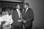Black Enterprise Magazine's Earl G. Graves talking with Tom Bradley, Los Angeles, 1987