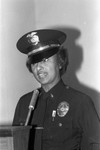 Policewoman at a lectern, Los Angeles