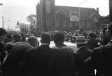 Cars moving through the crowd on Auburn Avenue to Ebenezer Baptist Church for Martin Luther King, Jr.'s funeral.