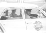 Eugene Harrison and another officer seated in a car during a student demonstration in Tuskegee, Alabama, to protest the murder of Samuel L. Younge, a civil rights worker.