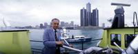 Young, Coleman A. ; Mayor Of Detroit. -Aboard Fireboat with Detroit Skyline in Background