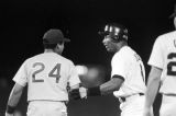 Bo Jackson talking to a player on the opposing team during a Birmingham Barons baseball game in Birmingham, Alabama.