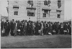 [African American] troops entering Camp Devens, Massachusetts.