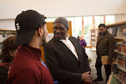 Mohammed Lawal with a Library Patron