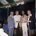 Donald Bohana posing with guests at an outdoor event, Los Angeles