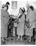 Chlora Hayes Sledge presents check to two women