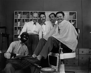Four men and one man in blackface on barbershop set NBC News Photographs