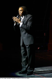 Curtis King speaking in spotlight Hip Hop Broadway: The Musical