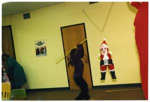 Young Girl Attacking Piñata During Christmas Party San Antonio Chapter of Links Records