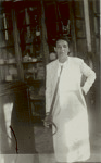 [Sabina holding historic sword], 1938 August