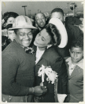 Lena Horne, African American actress, singer, and sponsor of the SS George Washington Carver, about to place a kiss on the cheek of Montrose Carrol, a chipper who worked on the Liberty ship, during the ship's launching, Richmond Shipyard No. 1
