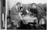 Men playing a board game, Japan, ca. 1932