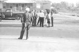 Representative Alton Turner, Willie Kolb, James Kolb, and others, talking outside during a civil rights demonstration in Luverne, Alabama.