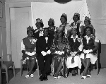 Group photograph of women wearing robes and crowns