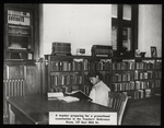 Work with schools, teachers' reference room : African American teacher preparing for promotional examination, 1938