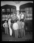 George Bailey talking with group of boys at All Nations Boys Club in Los Angeles, Calif., 1948