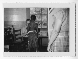 Photograph of a white doctor examining an African American girl, Clarkesville, Habersham County, Georgia, 1953