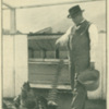 Booker T. Washington feeding chickens