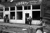 People standing in front of the Silver Sands Restaurant and the Liberty Contracting Company in Birmingham, Alabama, after the bombing of 16th Street Baptist Church.