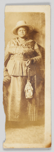 A photographic postcard of an unidentified woman