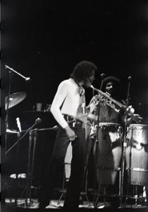 Miles Davis in performance: Davis (trumpet) and James Mtume (congas)