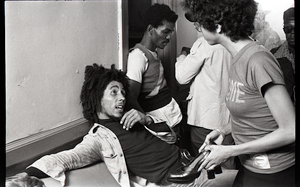 Bob Marley and the Wailers at Paul's Mall: Marley backstage speaking with a woman, in background Carlton Barrett, Aston Barrett, and Joe Higgs