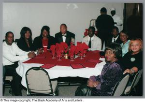 Guest goers attending Christmas Kwanzaa soiree Christmas/Kwanzaa Soiree