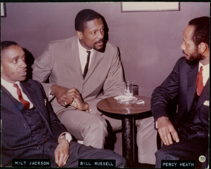 Milt Jackson, Bill Russell, and Percy Heath, sitting around a table, talking, probably at the Jazz Workshop