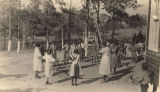 African American children playing in a schoolyard.
