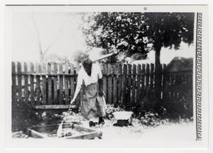 African American Woman Tending Fire